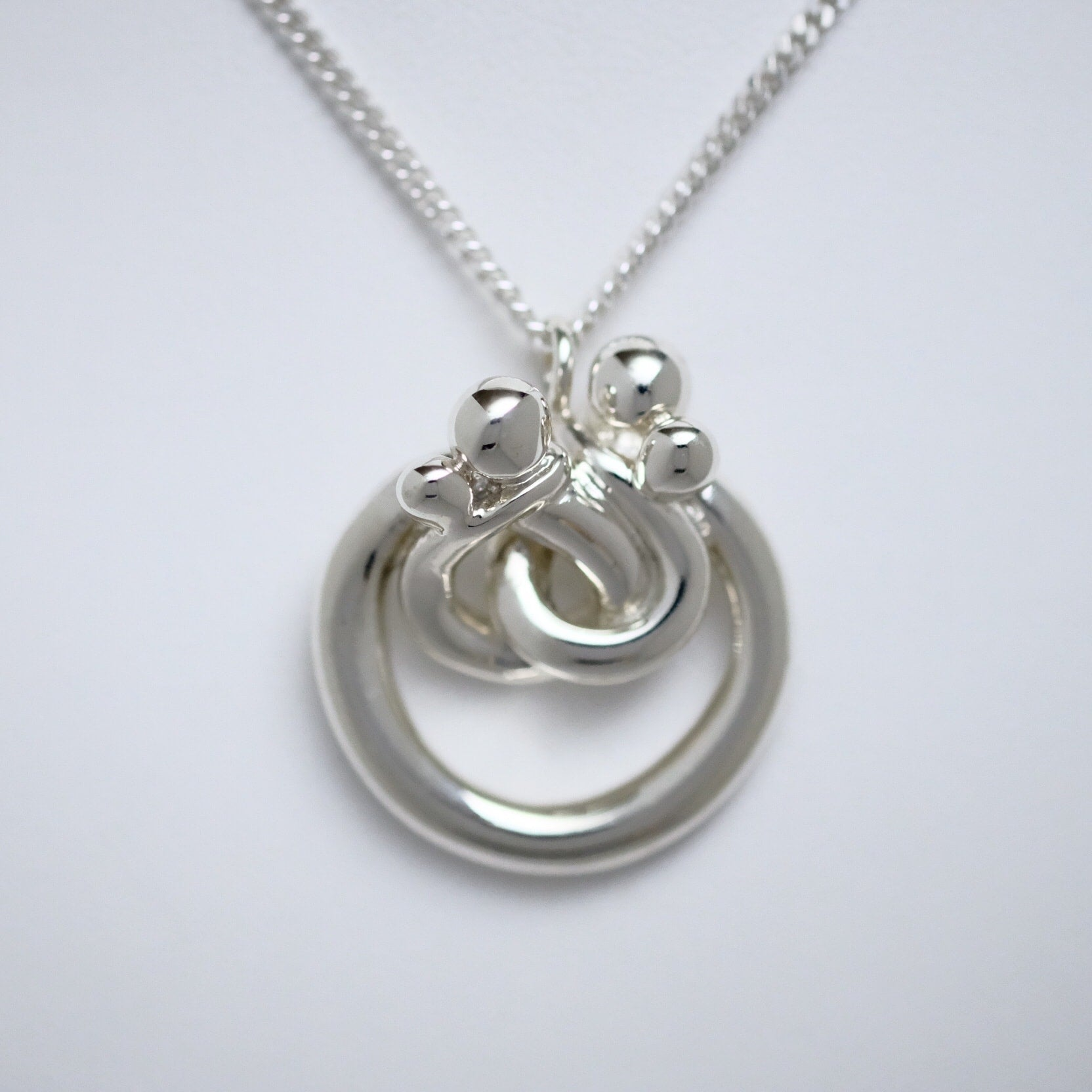Family of Four large circle Line of Love sterling silver pendant by Joseph Chiang