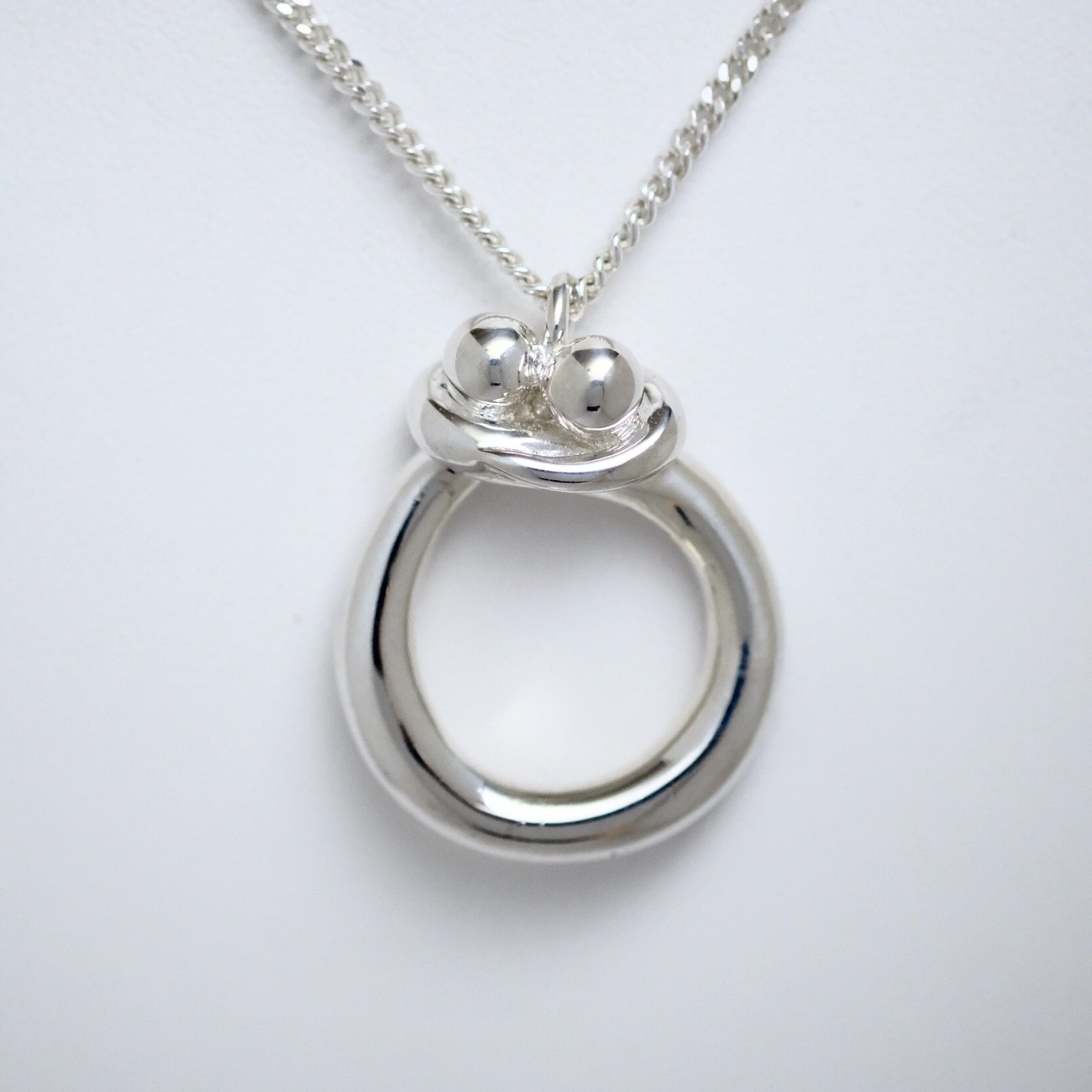 Embrace sterling silver pendant by Line of Love Jewellery