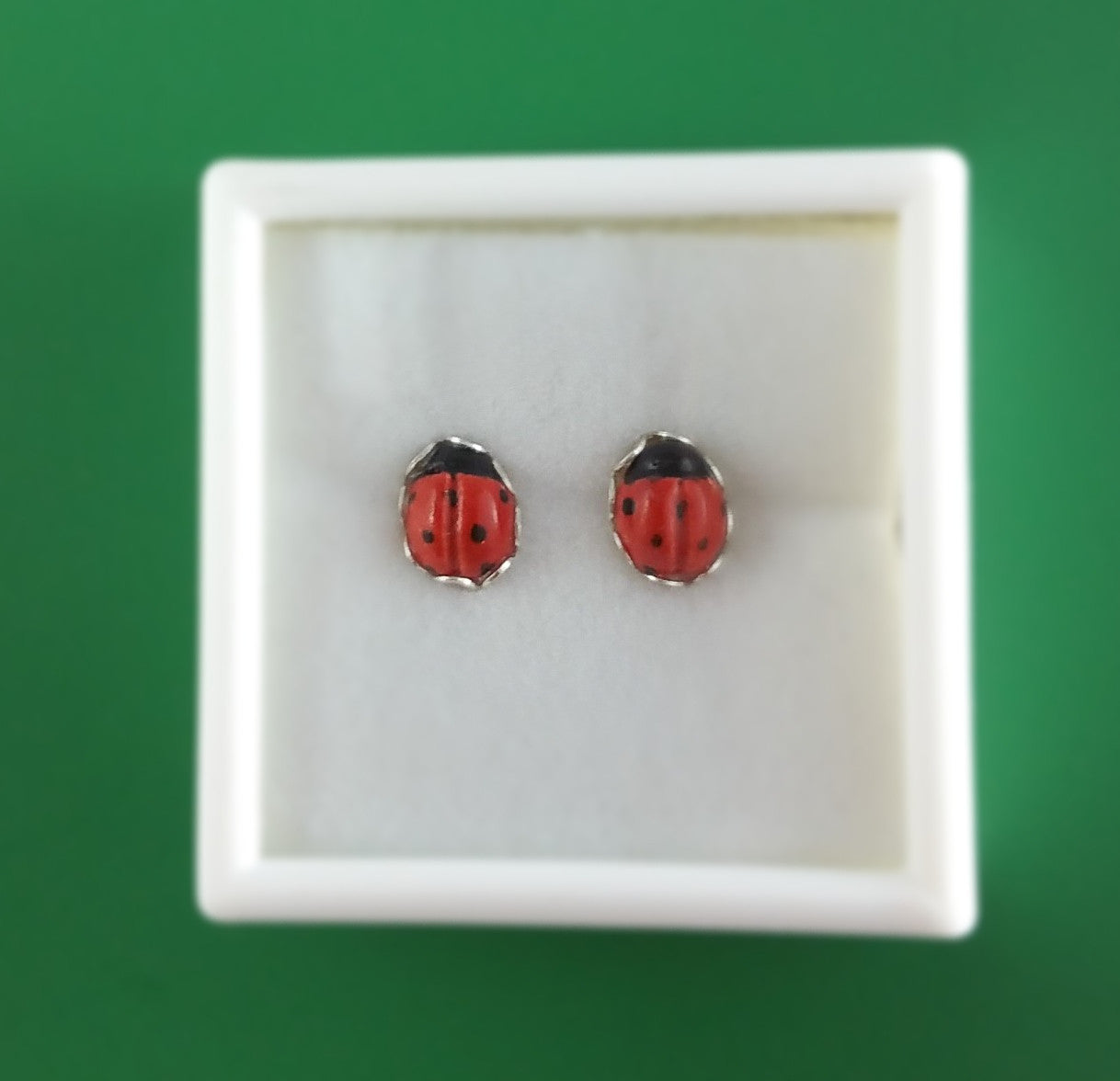 Small porcelain ladybug stud earrings with silver by Joseph Chiang