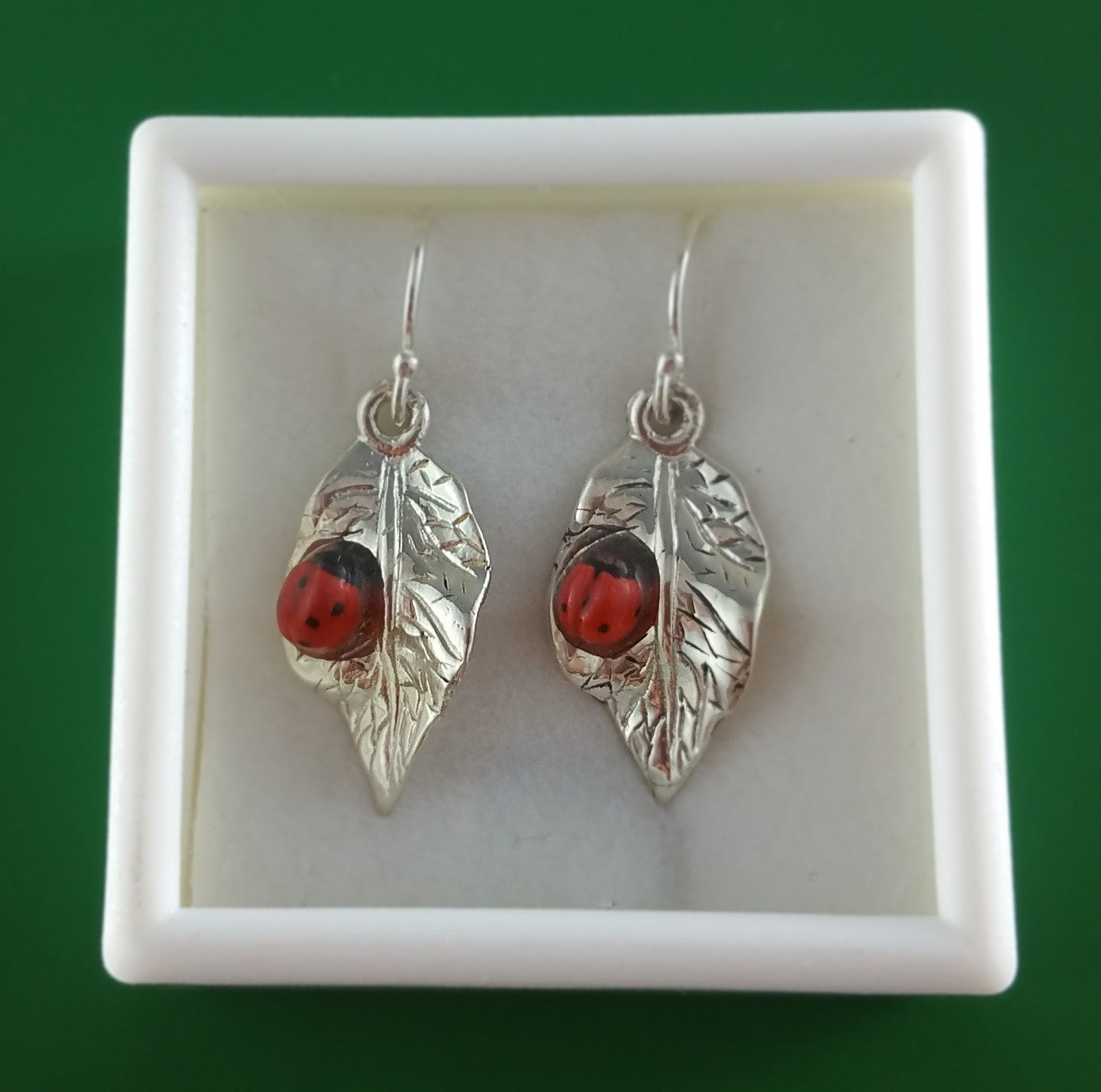 Sterling silver leaves with porcelain ladybug hook earrings by Joseph Chiang