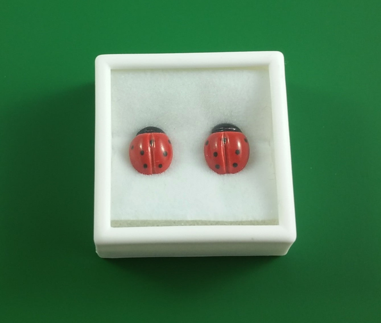 Medium porcelain ladybug stud earrings by Joseph Chiang