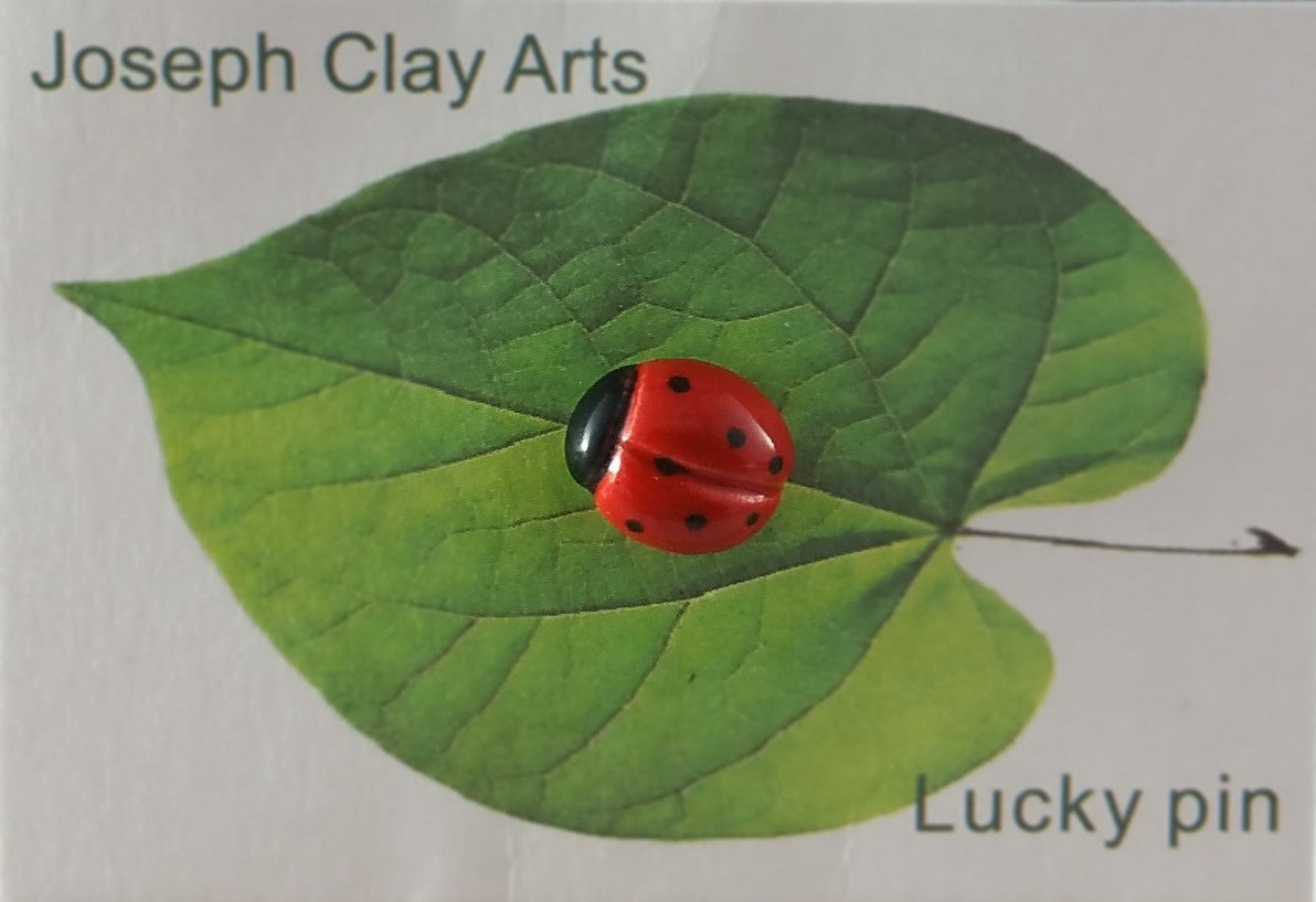 Medium handpainted porcelain ladybug pin by Joseph Chiang