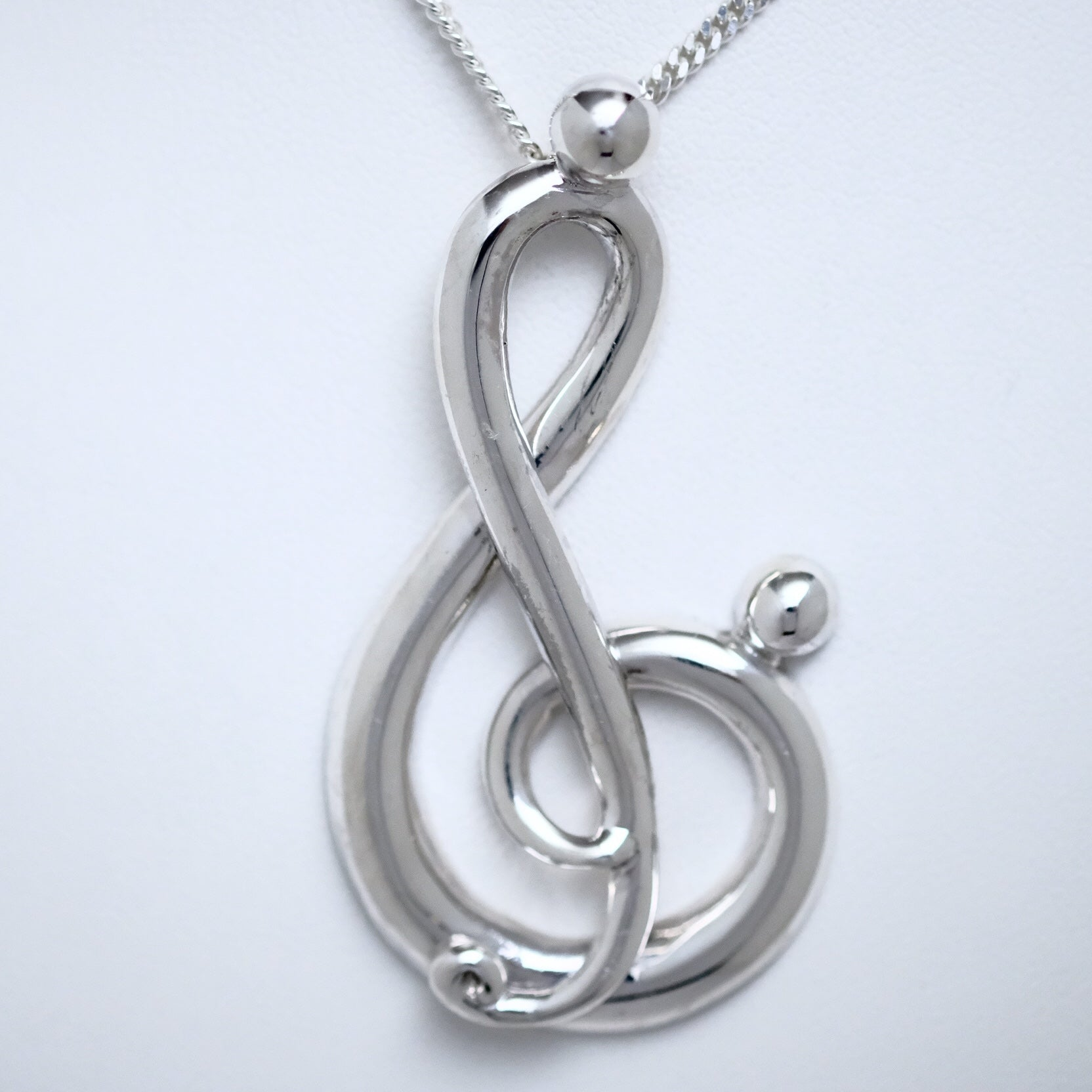 Melody of Love half side extra large sterling silver pendant by Joseph Chiang