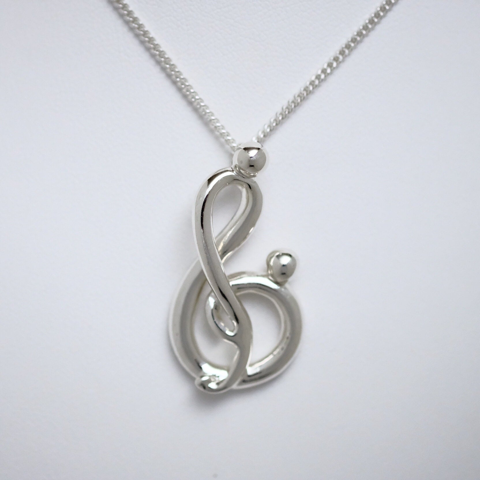 Melody of Love large sterling silver pendant by Joseph Chiang