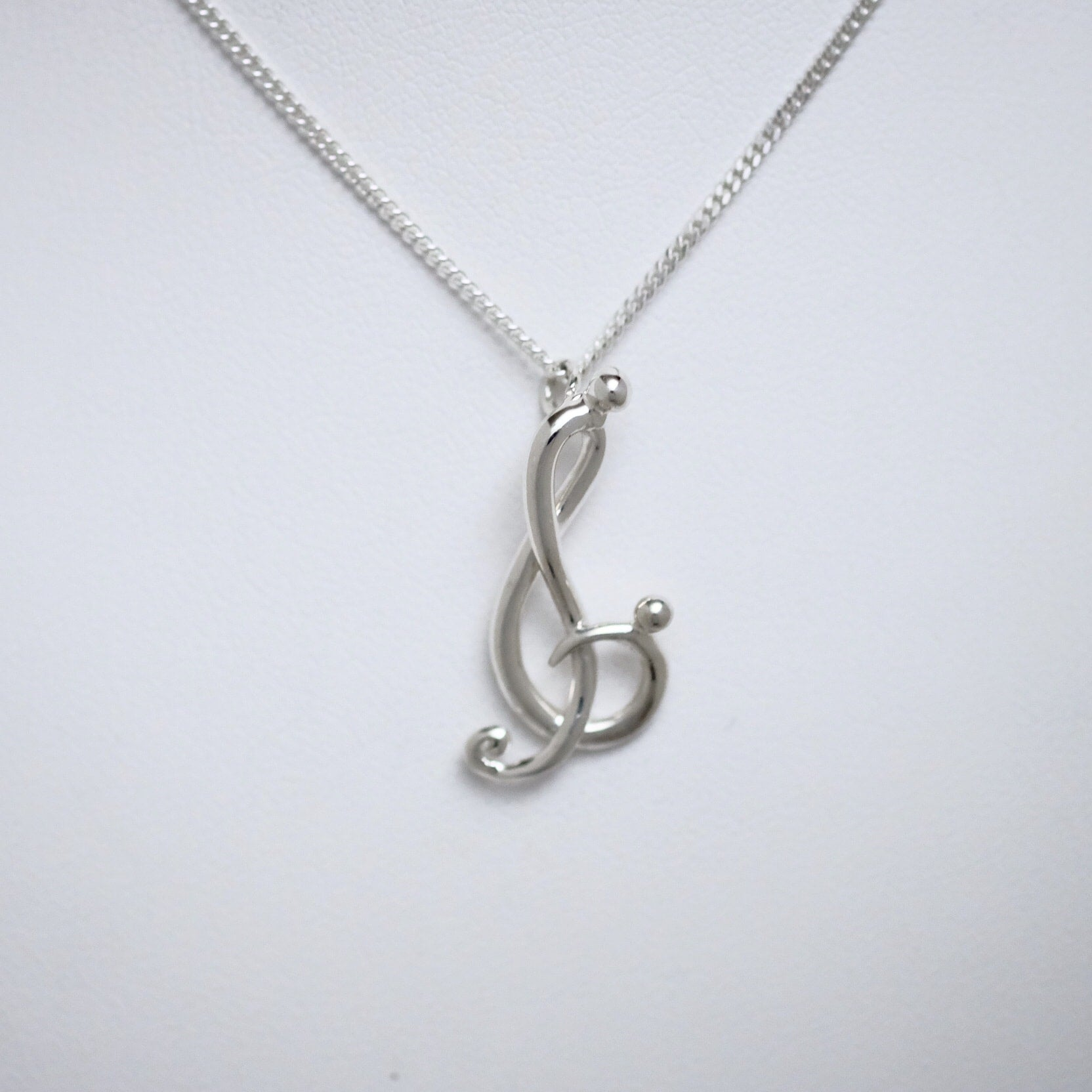 Melody of Love small sterling silver pendant by Joseph Chiang