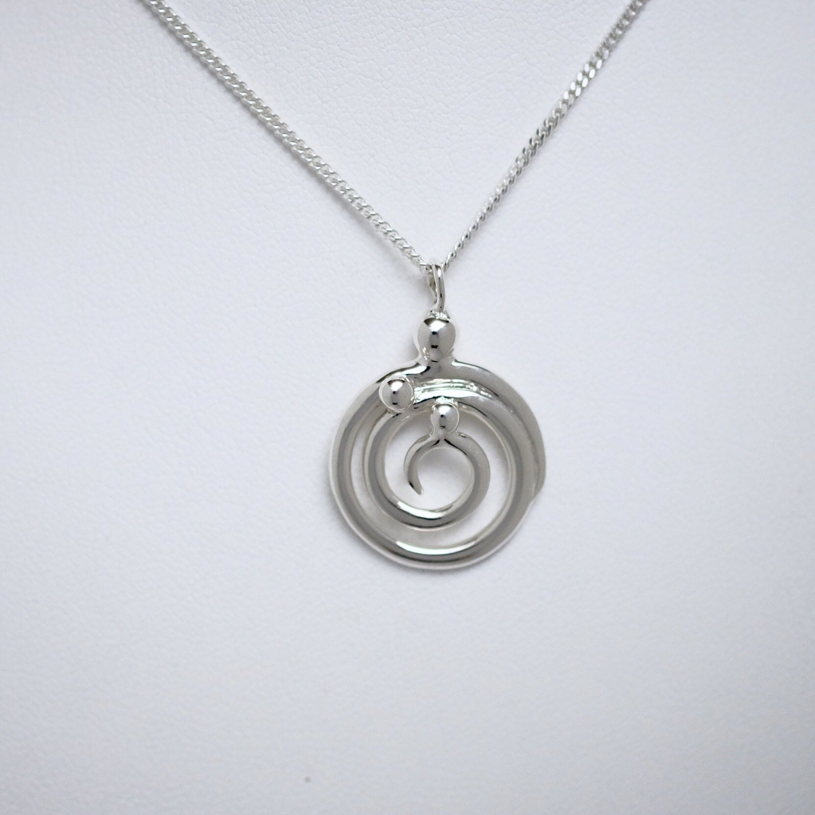 Mother & Two Children Family of Three circle pendant Line of Love Jewellery by Joseph Chiang