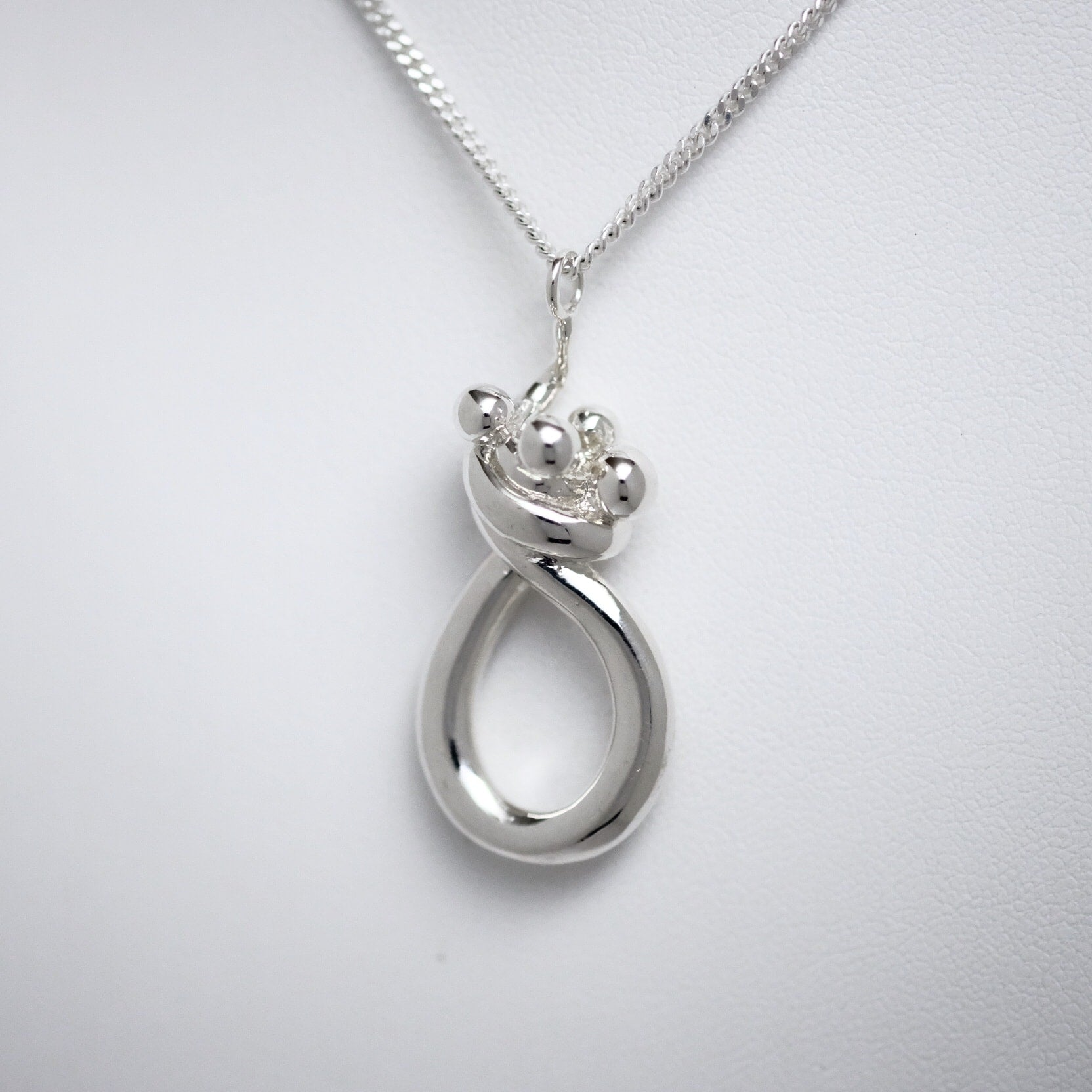 Mother & Three Children sterling silver pendant Line of Love Jewellery by Joseph Chiang