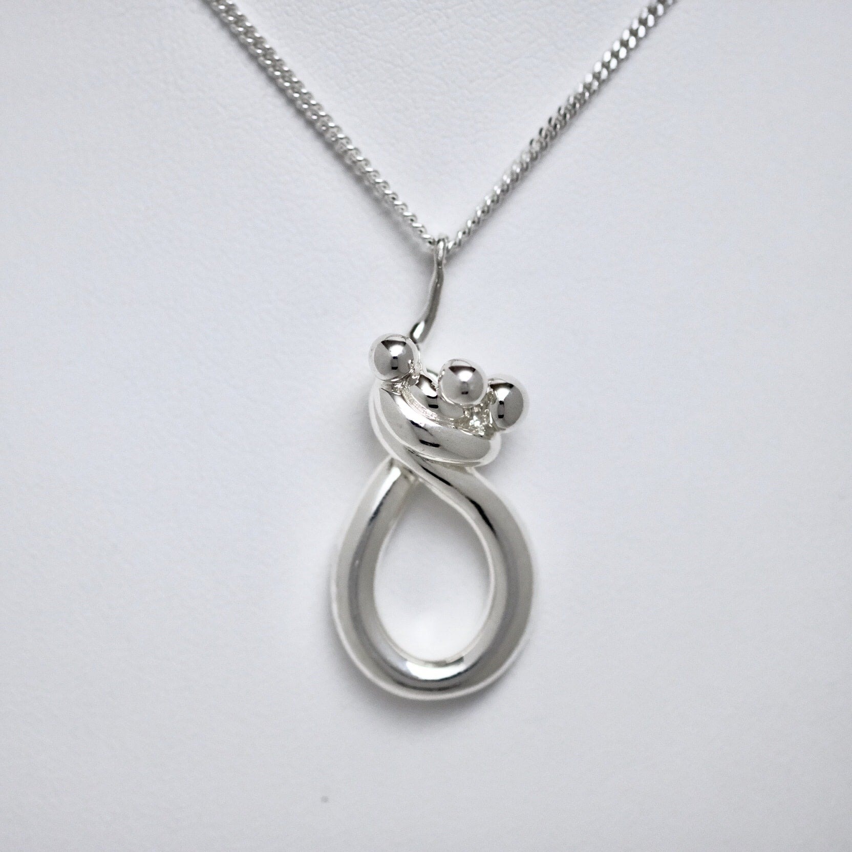 Mother & Two Children Line of Love sterling silver pendant by Joseph Chiang