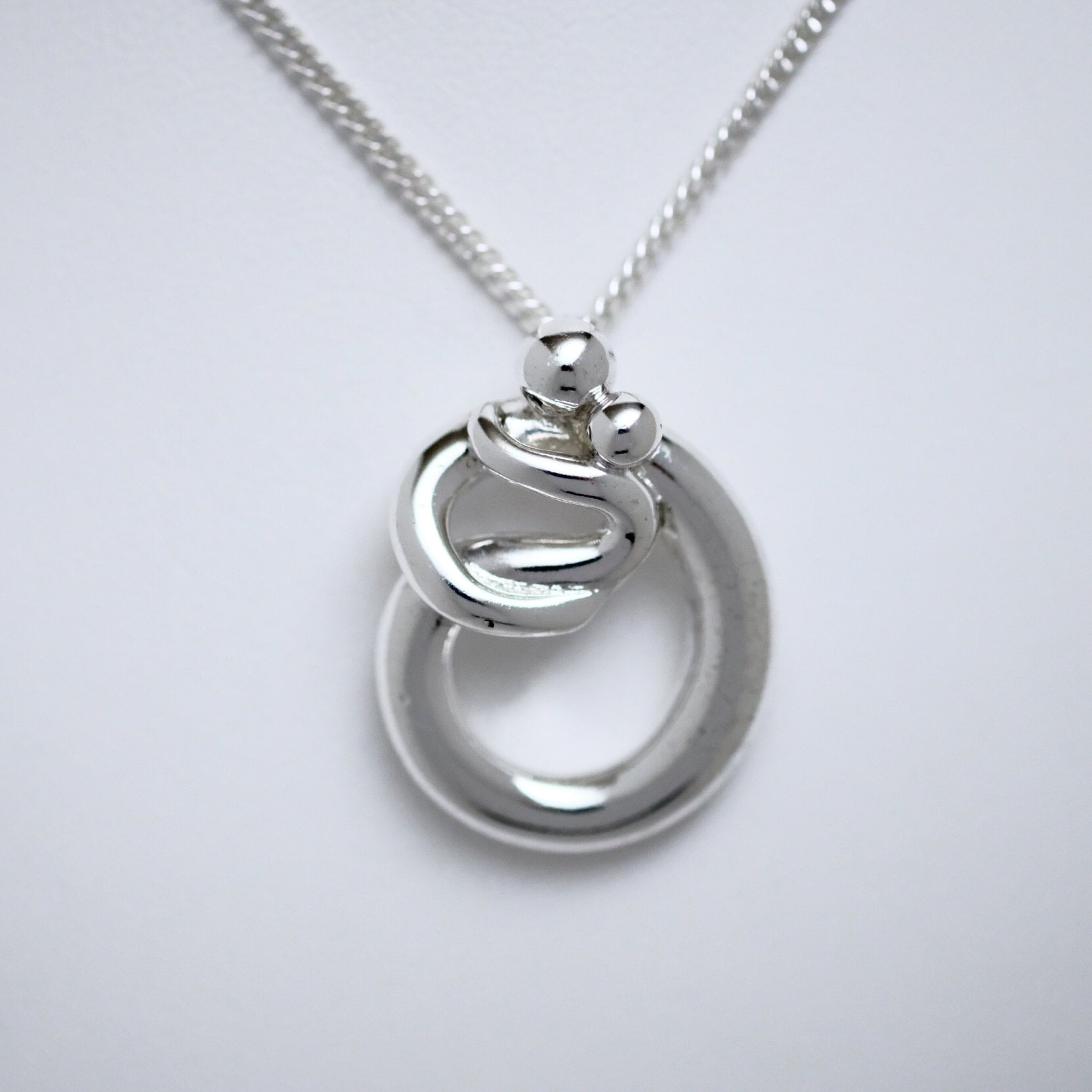 Parent & Child large pendant Line of Love Jewellery by Joseph Chiang