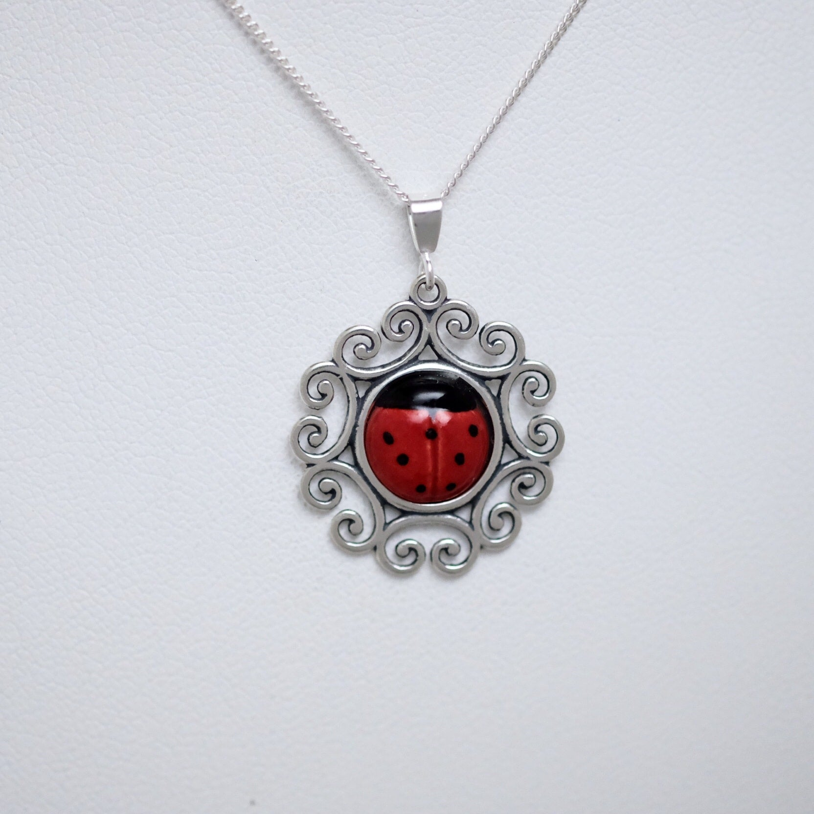 Porcelain ladybug with floral silver base (large pendant) by Joseph Chiang