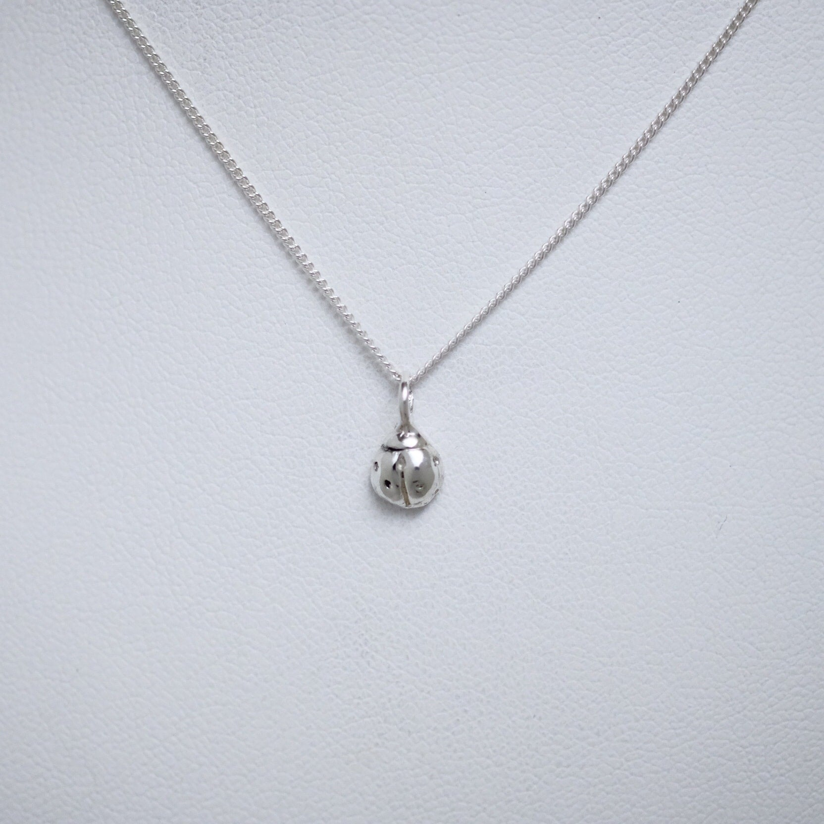 Small sterling silver ladybug necklace by Joseph Chiang