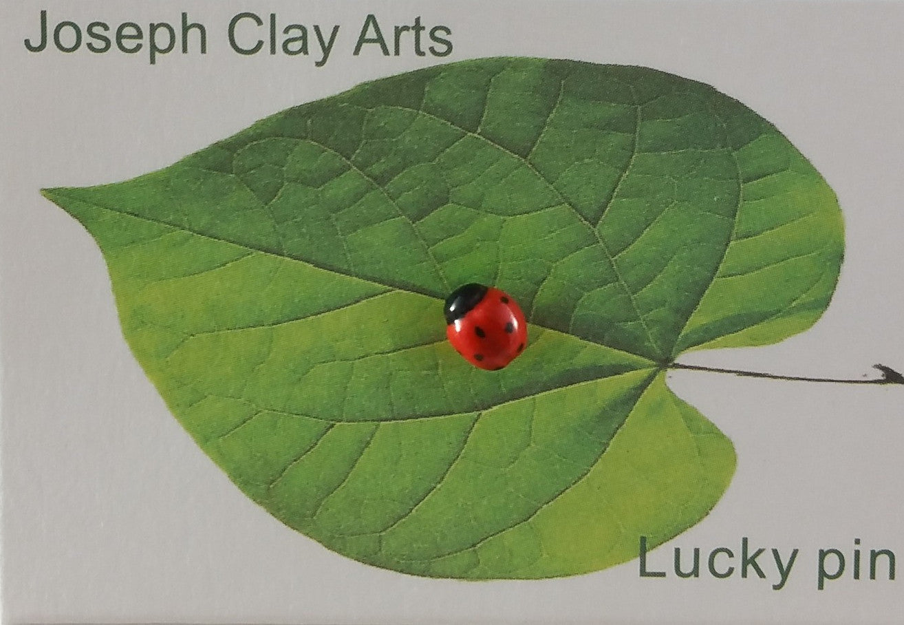 Small handpainted porcelain ladybug pin by Joseph Chiang