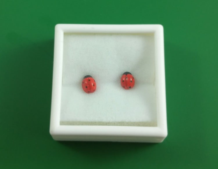 Small porcelain ladybug stud earrings by Joseph Chiang