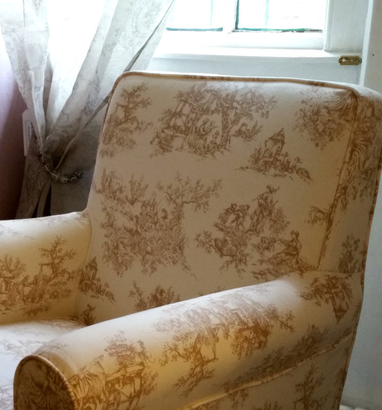 Toile loose cover arm chair.