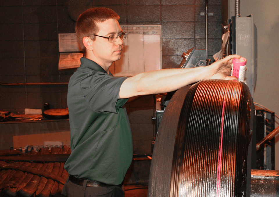 Recapping the Tire with Premium Rubber During the Mold Cure Retread Process