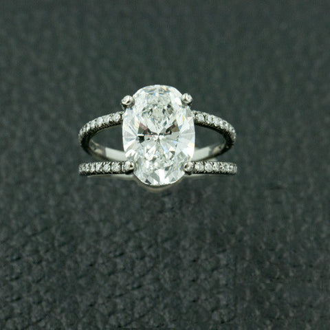 Center Oval Diamond Ring