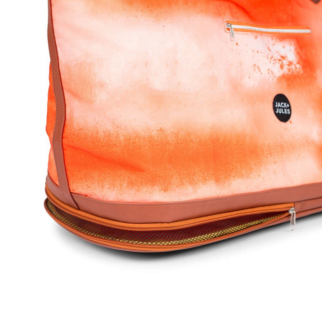 Zip sand-release detail of large Coastal beach bag in sunset orange