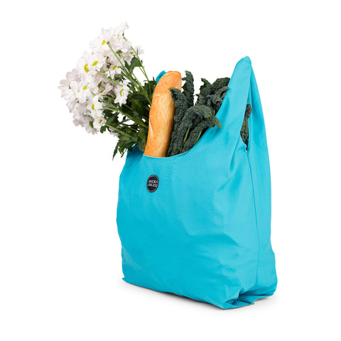 Single reusable market bag in aqua blue filled with shopping