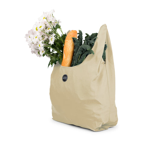 Single reusable market bag in tan filled with shopping