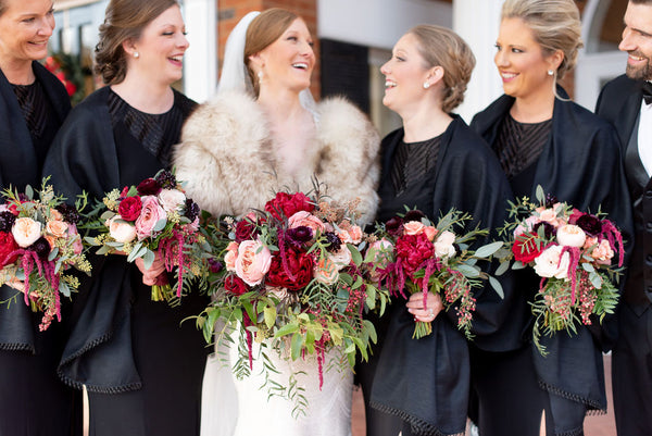 winter wedding bridesmaids black dresses greenery and burgundy flowers