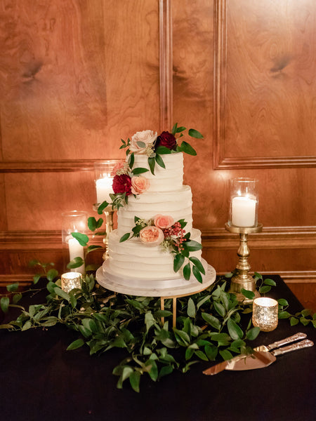 wedding cake with greenery and pink english roses