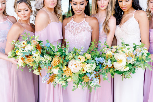 blush pink bridesmaids dresses with peach flowers