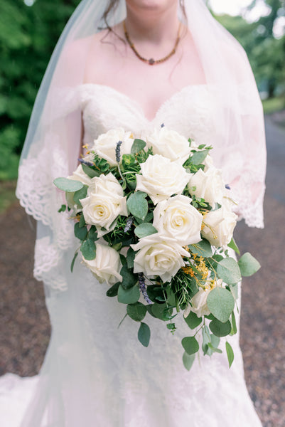 white wedding flowers roses and greenery
