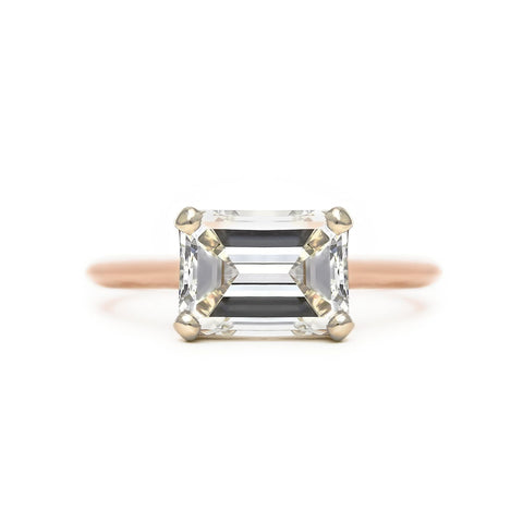 Emerald cut diamond solitaire east west engagement ring