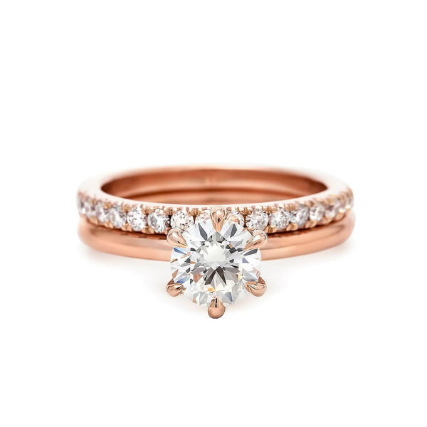Rose gold claw prong engagement ring and eternity band