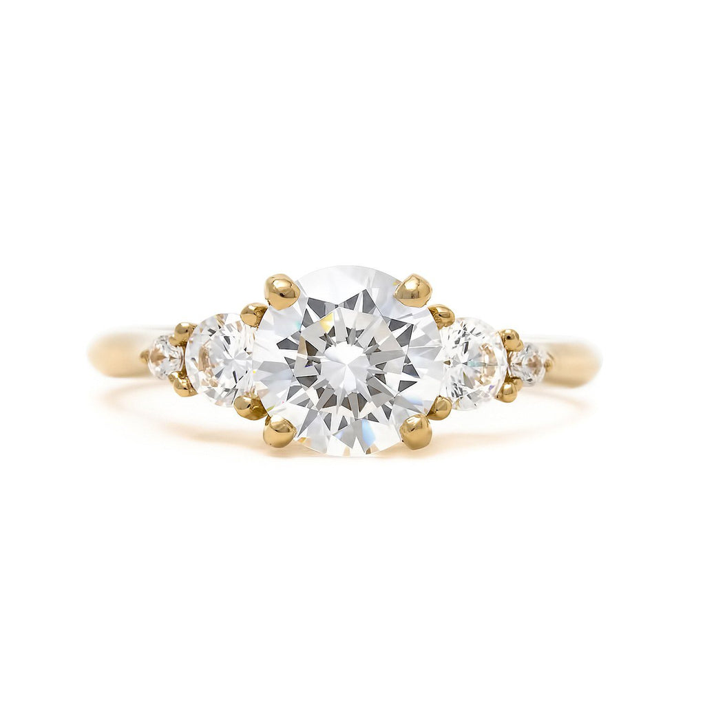 Ethereal five stone tapered engagement ring