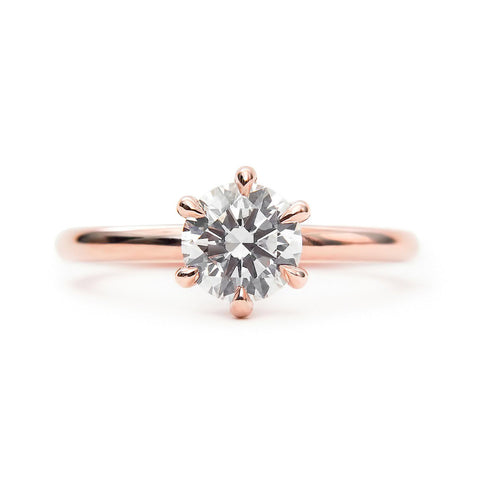 Claw prong diamond solitaire ring