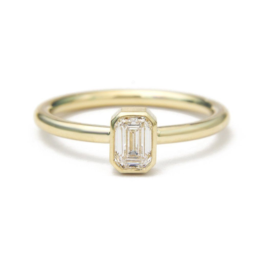 Emerald cut diamond bezel set ring