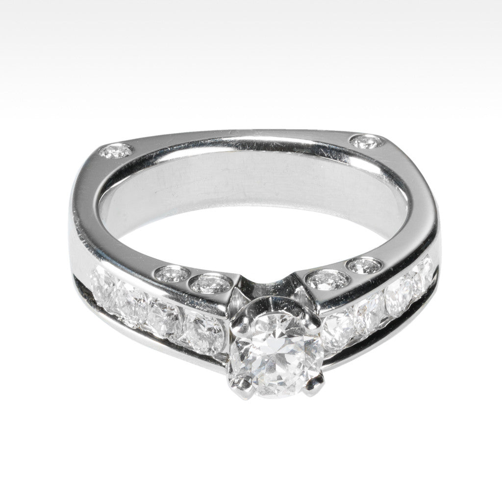 """Diamonds Galore""  Round Brilliant Diamond Ring with Channel Set Side Diamonds in 18K White Gold - Lyght.com"