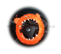 Orange fuzzy faux fur monster steering wheel cover with googly eyes