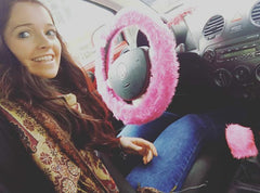 Barbie Pink fuzzy faux fur car steering wheel cover with happy customer sitting in car and barbie pink gear knob cover