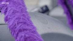 Purple fuzzy faux fur steering wheel cover on BBCs Ali-A's Superchargers