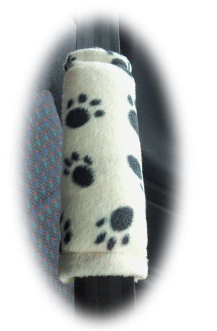 1 pair of fleece paw print car seatbelt pads white and black and multicolour