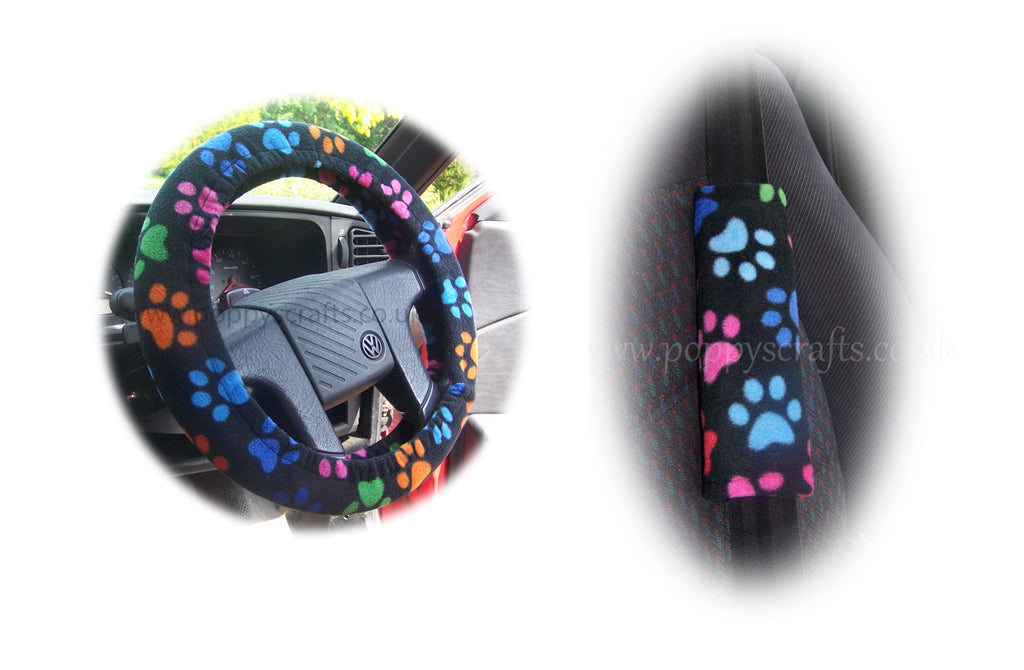Multi-coloured paw print steering wheel cover and seatbelt pads on black fleece