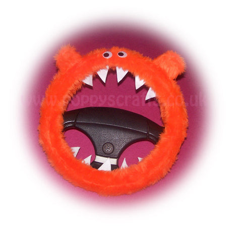 Fuzzy faux fur Tangerine Orange Monster steering wheel cover with googly eyes, ears, and teeth. fluffy furry car fun