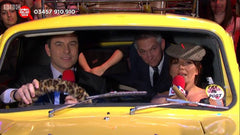 David Walliams, Gary Lineker and Davina McCall in yellow three wheeler van with leopard print fuzzy steering wheel cover for BBC's Sport Relief