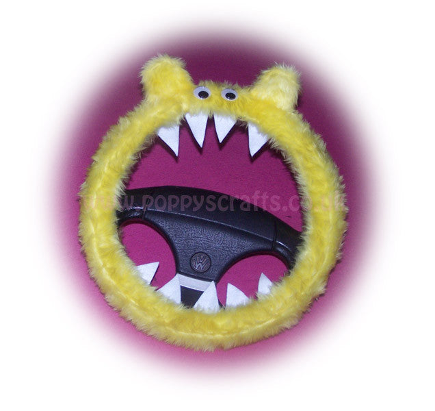 Fuzzy faux fur Yellow Monster steering wheel cover with googly eyes, ears, and teeth