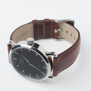 AR/WE Sweden (arweswe and arwe sweden) black watch with genuine brown leather strap. Simplistic and minimalistic watch from Sweden for both him and her.