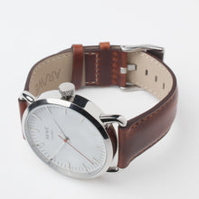 AR/WE Sweden (arweswe and arwe sweden) white watch with genuine brown leather strap. Simplistic and minimalistic watch from Sweden for both him and her.