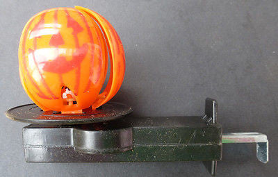 Vintage 1980s Halloween Whirling Pumpkin revealing Witch Push Button Spinner Toy