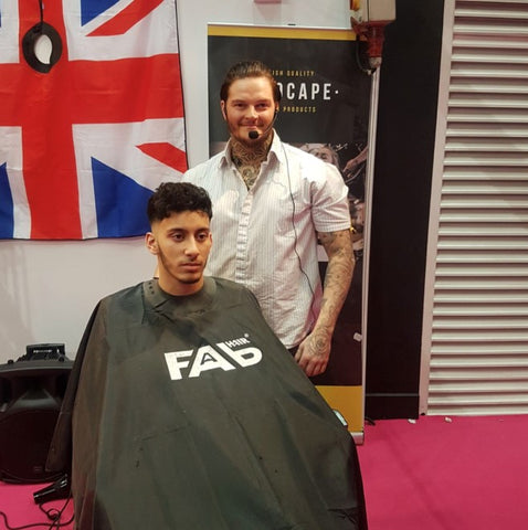 Man wearing Fab Hair Friction NeoCape