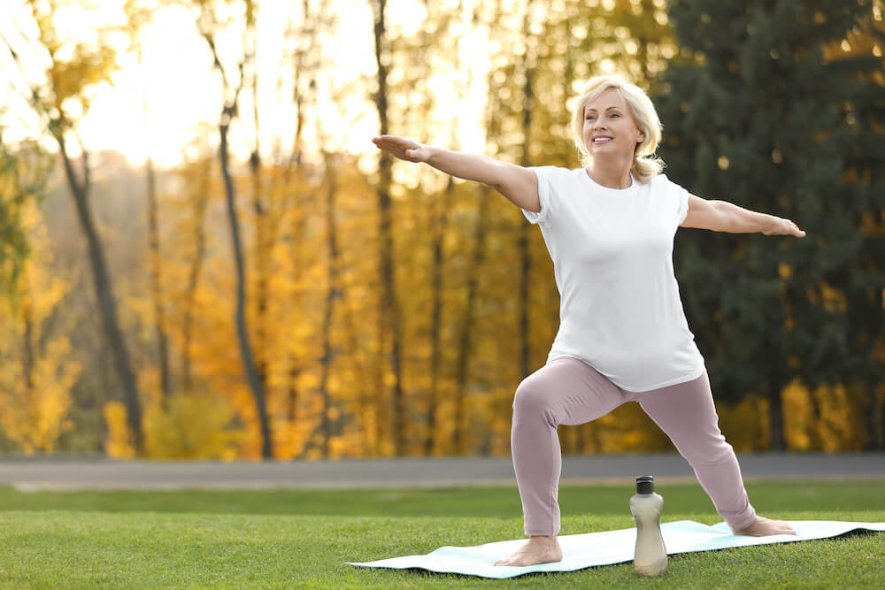 Woman in warrior yoga pose.