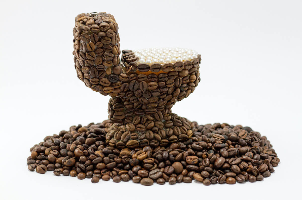 Why Does Coffee Make You Poop?, toilet made of coffee beans.