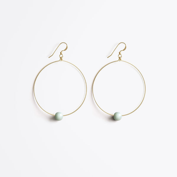 Globe large hoop earrings