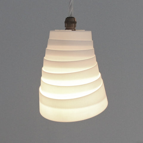 interesting lighting, 3Dprinted moving lampshade, conical rings, directional lighting, maneuvre lampshade