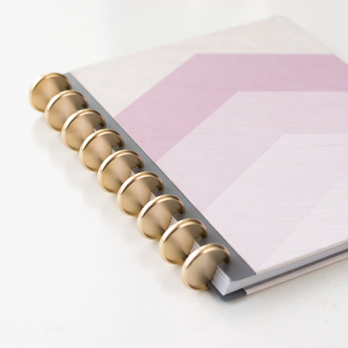 Purple geometric agenda with 9 gold discs